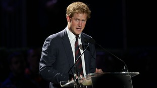 Prince Harry on stage during his speech.