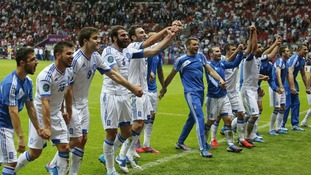 The Greece team celebrate their qualification.