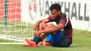 Sturridge rests during a training session for England.