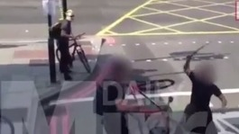 Man wielding huge baton attacks cyclist on a busy street