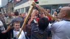 Olympic flame passed between torchbearers