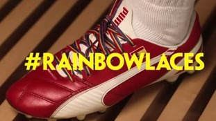An Arsenal player's boot displaying rainbow-coloured laces