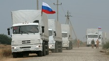A Russian convoy of aid tanks arrives yesterday evening.