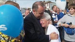 Salmond hugs woman