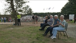 audience in front of the Cairn monument