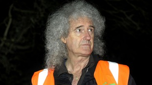Brian May taking part in a badger patrol