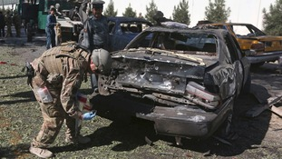 A US soldier carries out an investigation at the site of a suicide attack in Kabul S