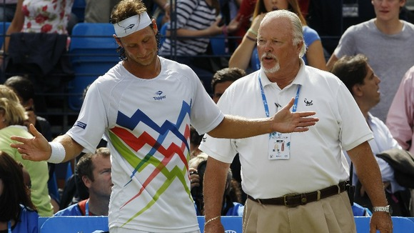 David Nalbandian talks to an ATP official following the incident.