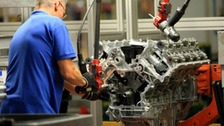 An engineer working on a Jaguar V8 engine