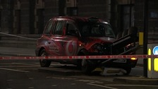 The taxi brought down a set of traffic lights in the collision
