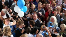 First Minister Alex Salmond gives thumbs up as he is mobbed whilst on a walkabout in Largs.