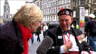 A charity collectors speaks to Julie Etchingham on the streets of Edinburgh.