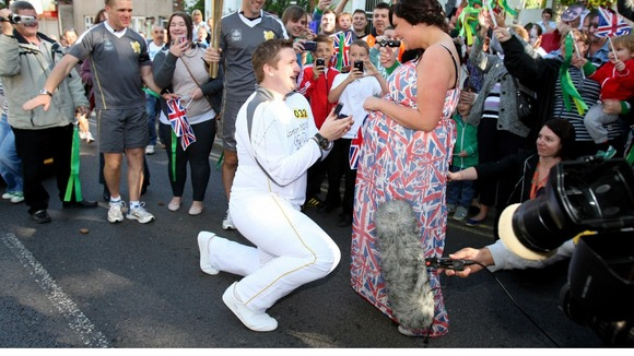 Torchbearer David State pops the question during the Olympic relay.
