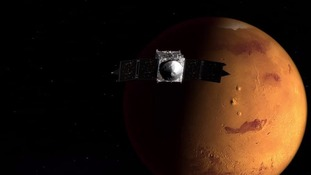Spacecraft fired at Mars to reach 'moving target' this weekend.