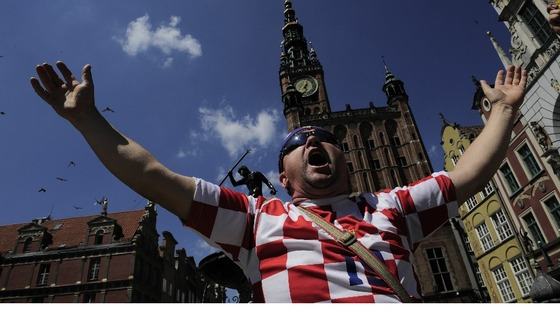A Croatia fan belts out a tune in Gdansk.