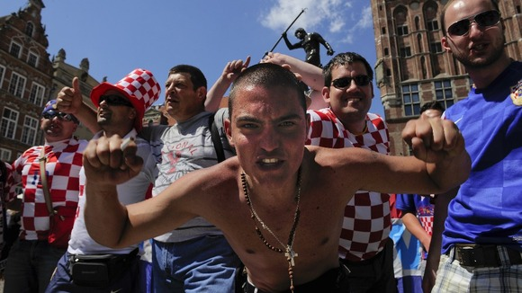 A Croatia fan looks fiercely into the camera.