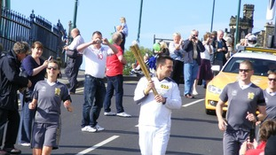 Robert Swift carries the torch along Saltburn's final leg of the relay