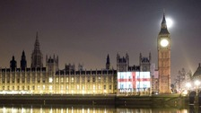 An English flag is projected onto the House of Commons.