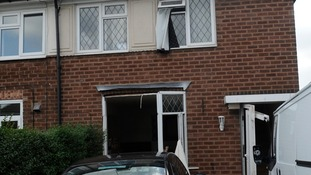 The explosion blew off downstairs doors and windows