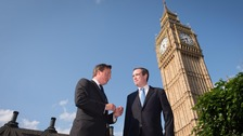 Prime Minister David Cameron talks with James Wharton MP (right) outside the Parliament, London