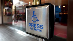 General view of a Disabled entrance door button