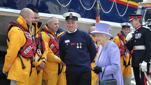 The Queen greeting the crew of RNLB The Princess Royal at St Ives in May 2013