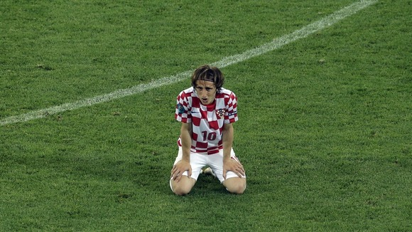 Croatia midfielder Luka Modric looks discontent after defeat to Spain.