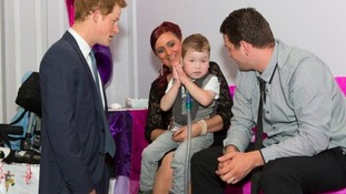 Prince Harry meets Carson Hartley aged four