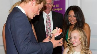 Olivia presents Harry with a pottery pig