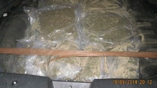 Officers discovered 10kg of herbal cannabis hidden in the spare wheel compartment of a car.