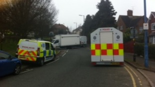Police remain in Perry Hill road while negotiators try to save 79-year-old woman being held at knife point