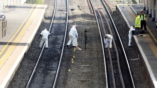 Forensic officers work on the tracks at Slough