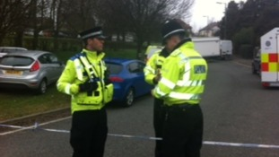 Police officers maintaining cordon in Perry Hill Road