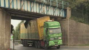 Isle of Wight rail services halted after lorry collides with bridge
