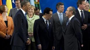 President Barack Obama looks to Mexican President Felipe Calderon