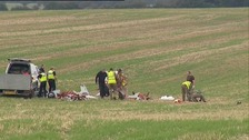 Investigators sift through wreckage of aircraft