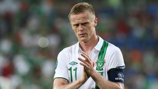 Republic of Ireland&#x27;s skipper for the night Damien Duff leaves the Poznan pitch.