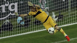 Spain goalkeeper Iker Casillas makes a crucial save from Croatia&#x27;s Ivan Rakitic.