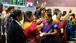 Scientists cheer after India's Mars orbiter successfully enters the red plant's orbit.