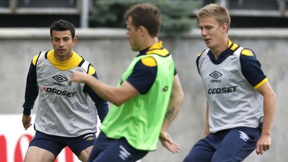 Sweden&#x27;s players control the ball during training on the Koncha Zaspa Training Centre pitch near Kiev.