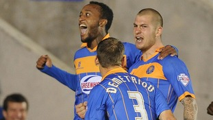 James Collins celebrates with Cameron Gayle and Mickey Demetriou after scoring his sides opening goal of the game against Norwich City