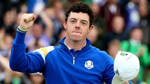 Europe's Rory McIlroy celebrates after winning his singles match