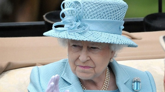 The Queen waves at the crowds as she arrives for the first day of Royal Ascot.