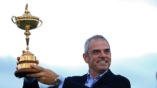 Europe's captain Paul McGinley holds the Ryder Cup.
