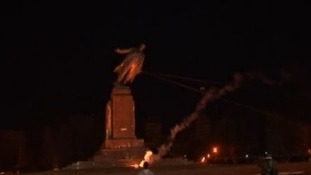 The statue is pulled down.