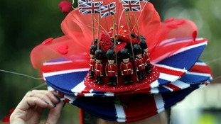 One race-goer wears a hat with the Union flag and toy soldiers on it.
