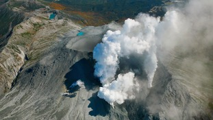 Volcanic smoke rises from Mount Ontake in central Japan, two days after a volcanic eruption.