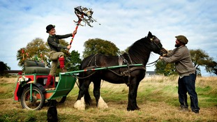 Artist Alice Francis with the 'standard' and horse-drawn cart, the centre pieces of the