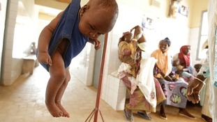 A baby girl is weighed in a sling scale at the Bilmari health centre in the town of Mirriah.