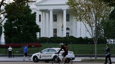Police positioned in front of the White House after the latest security breach.